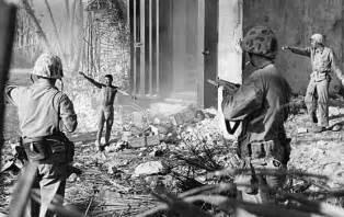 World war ii u s marines taking a japanese soldier prisoner