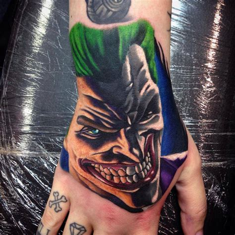 joker hand tattoo motocross on chest by paul priestley