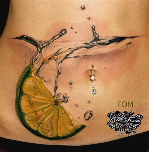 cocktail with lime slice on woman s stomach best tattoo