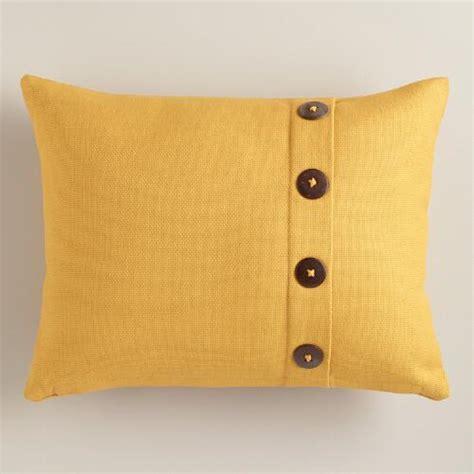mustard yellow basketweave lumbar pillow with button