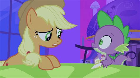 my little pony spike and applejack image applejack seeing spike holding cadance figurine