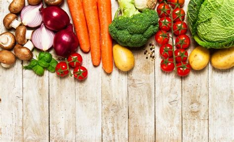 Veggie Table by Different Vegetables On A Wooden Table Photo Premium