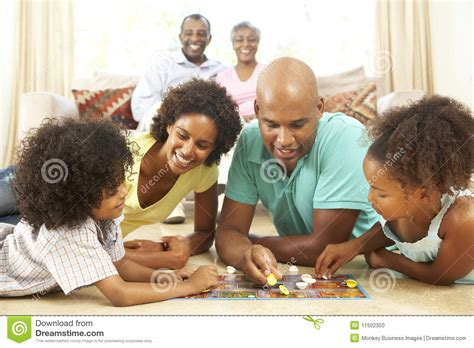 to play at a family board at home stock photo image