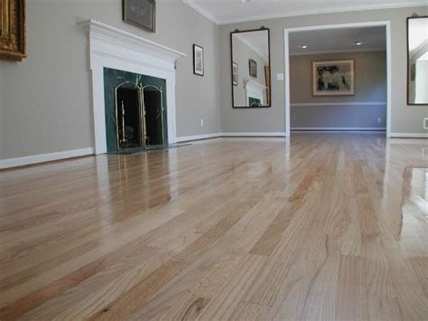 Red oak floor refinished from a dark brown stain to