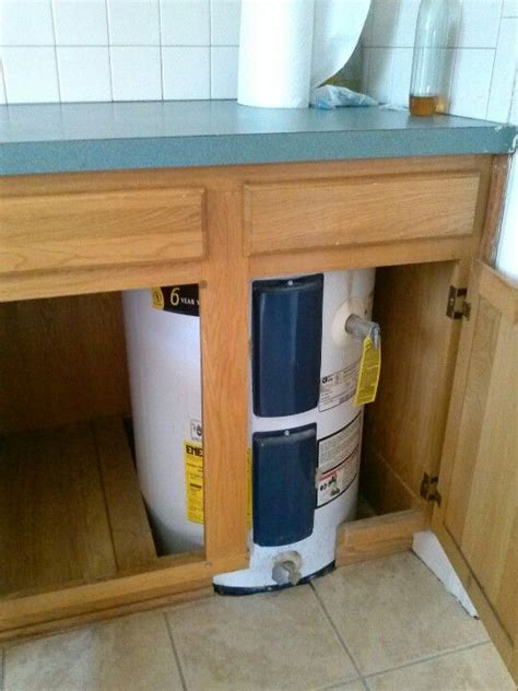 cabinet water heater water heater in kitchen cabinet or buy a big one and
