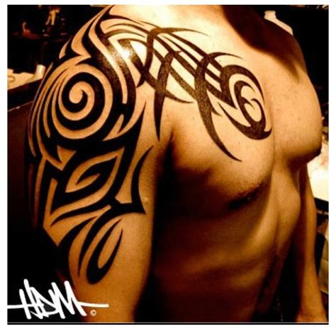 tribal shoulder and chest tattoos hector daniel morales certified artist