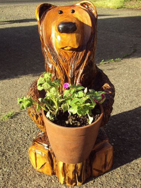 chainsaw carved flower pot bear   gavinh