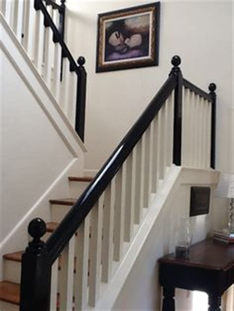 white entryway with stairway with black banister