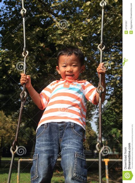 play boy swing videos japanese boy on a swing stock image image of play clear