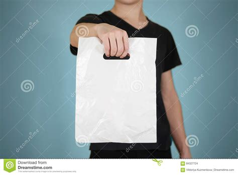 escalade commercial white guy carrying bags man shows blank plastic bag mock up and thumb up isolated