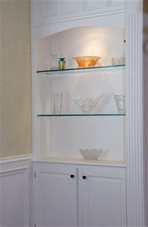 glass shelves with lights built in custom built ins flanking the fireplace with glass by best