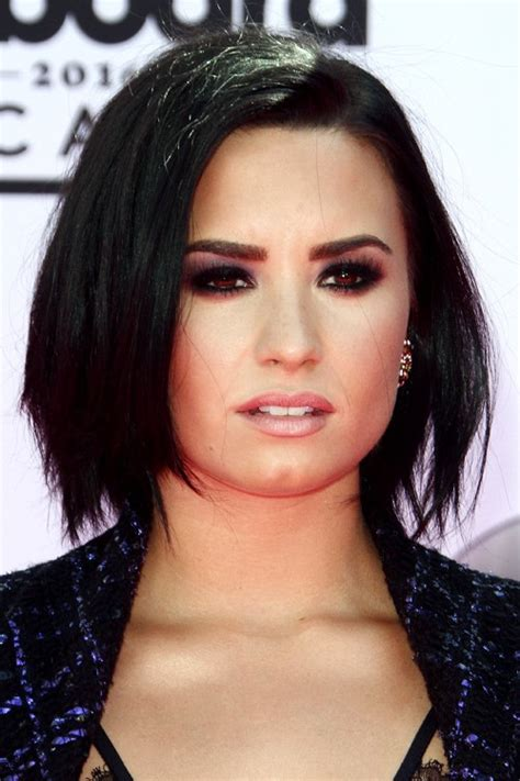 demi lovato s hairstyles amp hair colors steal her style