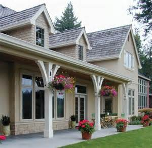 house plans with covered porches wrap around and covered porch decor craftsman porch columns and flower