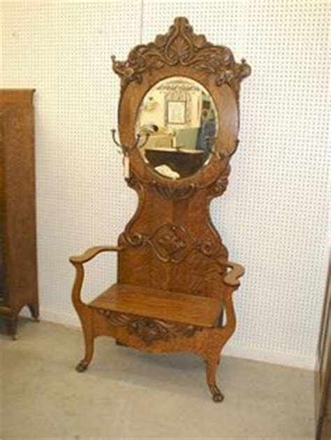 antique oak hall tree with bench and mirror antique oak entry hall tree with storage bench beveled
