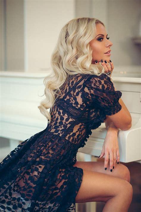 black doll sitting on bed dress black dress see through blouse