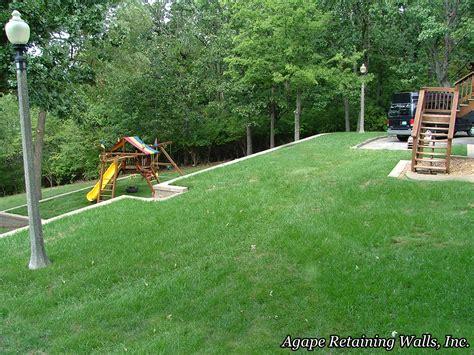 backyard slopes away from house sloped yard retaining walls and yards on pinterest