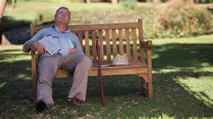 park bench movie ws old man waking up on bench in park cape town western