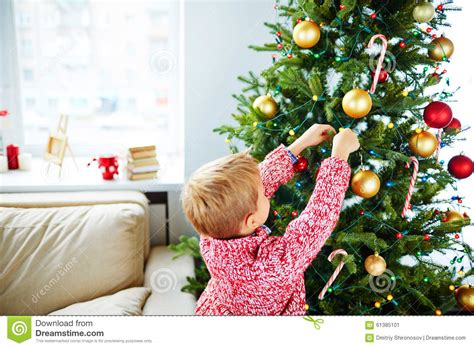 christmas tree preparation preparing for stock image image of child garland 61385101