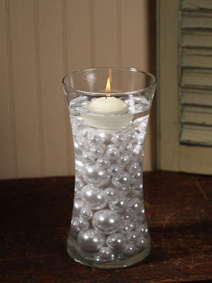 wedding centerpieces with candles and pearls three different sized pearls and floating candle in