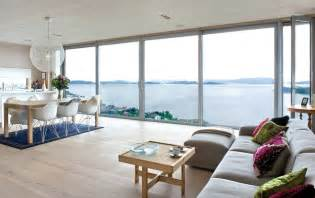natural lighting home design 30 floor to ceiling windows flooding interiors with