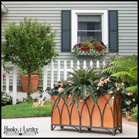 Iron Planters For Outdoors by Arch Wrought Iron Planters Outdoor Hooks Lattice