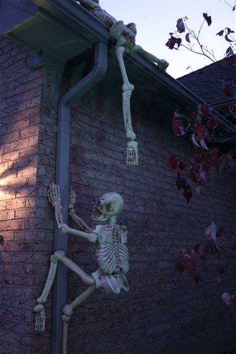 skeletons climbing house 28 scary outdoor halloween d 233 cor ideas shelterness