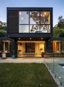 modern box house contemporary post beam residence at the bottom of a slope in auckland
