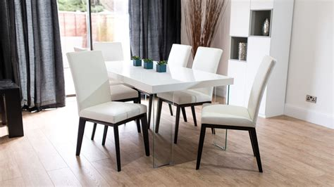 modern white gloss dining table glass legs seats