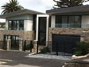 Cladded 35 house photos with stone clad design