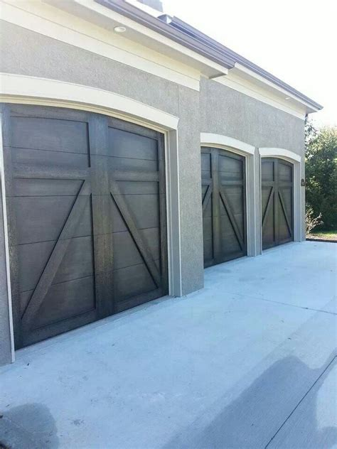 painted garage door the magic brush faux wood painted garage doors garage
