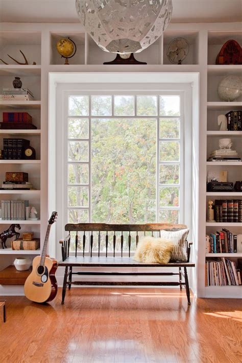 window bench and bookshelves built ins around an incredible window with a comfy bench