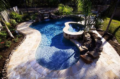 backyard lagoon tropical lagoon pool with grotto waterfall and spa stream