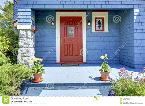 red house with a porch photograph by les palenik blue entrance porch with red door stock image image