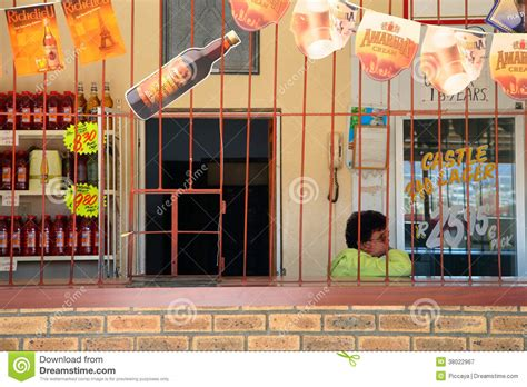 printable grocery coupons cape town employee sitting inside her grocery south africa