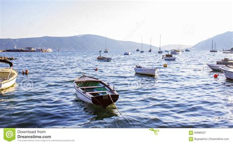 small boat on water many small boats on calm water stock photo image 85886537