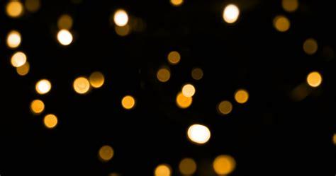 Amazing Christmas Kights #6: Defocused-bokeh-gold-christmas-light-on-dark-background-vertical-pan_vk8shkjxg__F0000.png