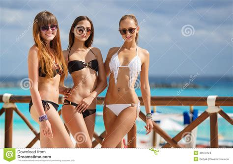 Girls In  Relax On The Background Of The Ocean. Stock Photo   Image: 49670124