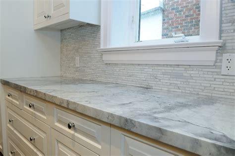 Carrara Marble Kitchen Backsplash by Granite Quartzite Marble Quartz Countertops Traditional