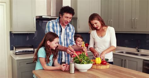 two kitchens family recipes parents with child cooking together at home stock footage video 15422104 shutterstock