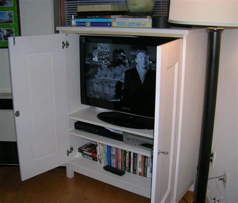Tv Storage Cabinet With Doors Brown Wooden Cabinet With Doors Also Three Shelves On The Middle With Plus