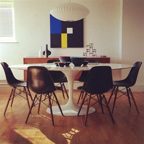 Eames Chair Dining Table Mcm Dining Black Reproduction Eames Fiberglass Chairs Around An Oval Saarinen Tulip Based Table