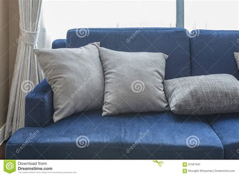 grey sofa with blue pillows grey pillows on classic blue sofa stock photo image