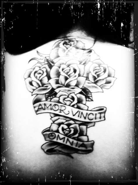 love conquers all latin tattoo designs this is my back for quot conquers all