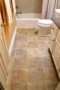 vinyl floor kohler toilet in white tile tub surround