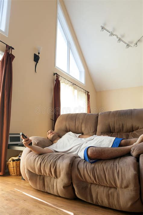 lazy on couch lazy man laying on the sofa stock image image 48459699