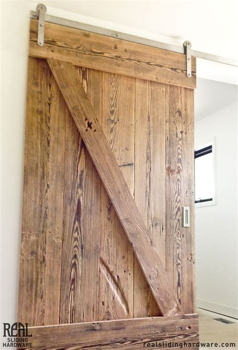 Rustic Sliding Barn Doors Knots And Grooves Add Rustic Character To This Sliding Barn Door That Divides A Stairwell