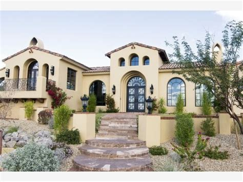 mediterranean style windows residential home exterior front the large windows