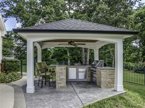 outdoor cooking area this impressive outdoor cooking area features a hip roof with arches over a decorative concrete