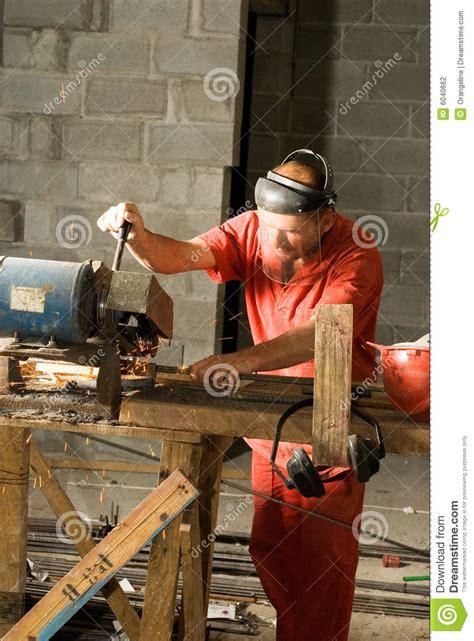 construction worker cutting rebar vertical stock