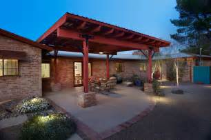 a sustainable ramada and backyard contemporary patio